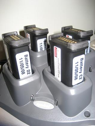 Shows 4 x Motorola (or Honeywell) MC9000 batteries charging