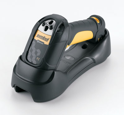 The Motorola LS3578 cordless laser scanner charging in the base cradle