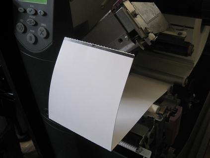 Tag stock has a perforation between each tag to make separation easier. The black mark on the back should come out just after the perforation for best results